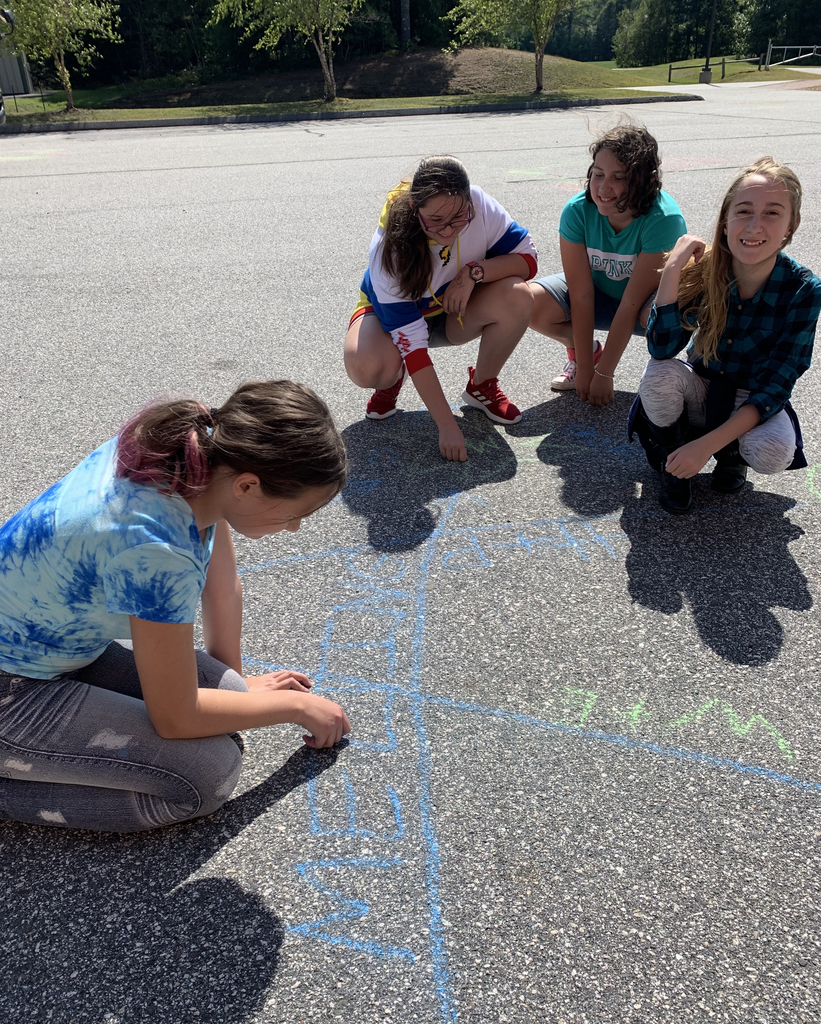 What a beautiful day! Mrs. Turner's science classes took advantage of the weather to chalk-talk the rock cycle! #sciencerocks