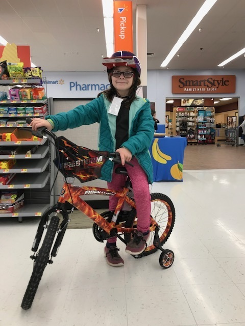 Jessica with her new bike and helmet!
