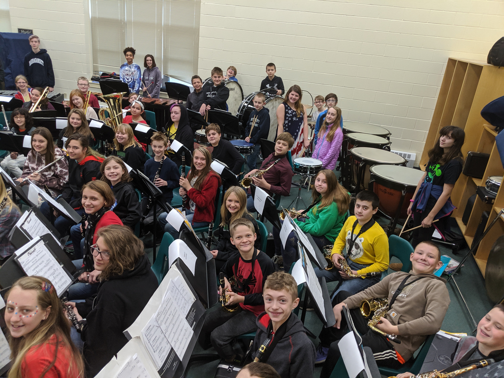 MMS students and their instruments at a full band rehearsal.