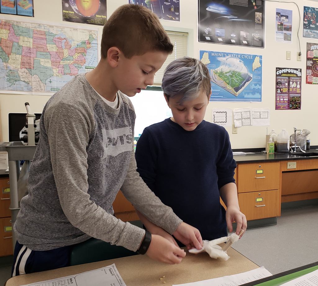 Two students making a catapault