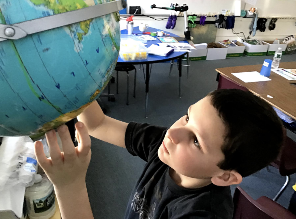 Studying the globe.