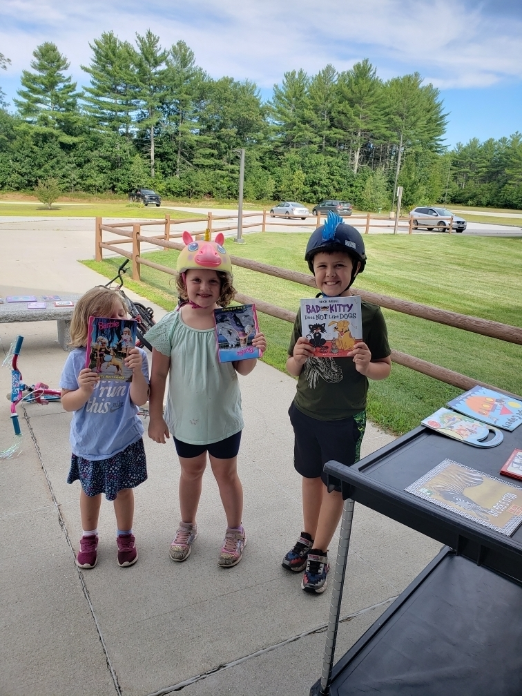 Happy kids with their choice of books!